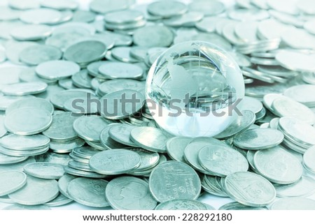 Globe on coins money, Money is God Concept. - stock photo