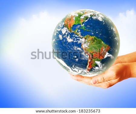 Globe on her hands, South and North America. Elements of this image furnished by NASA