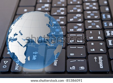 Globe on laptop keyboard.