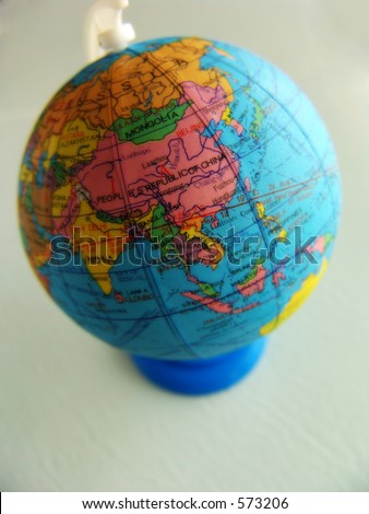 Globe on stand, light background.