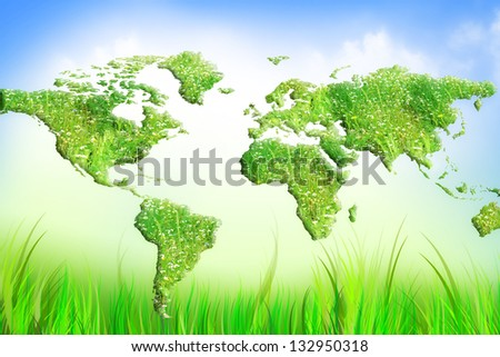 Globe on the green grass map - stock photo