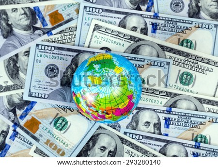 globe on US dollar bill concept background