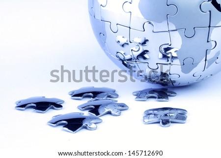 Globe puzzle - stock photo