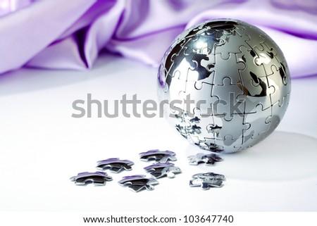 Globe puzzle isolated on white background - stock photo