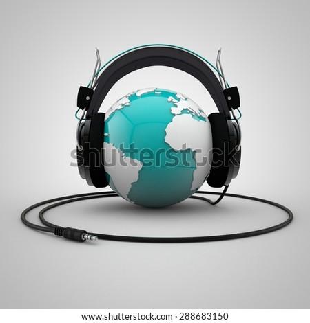 Globe with headphones - stock photo