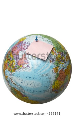 Globe with pinned paper note