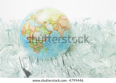 Globe with Tinsels on White Background - stock photo