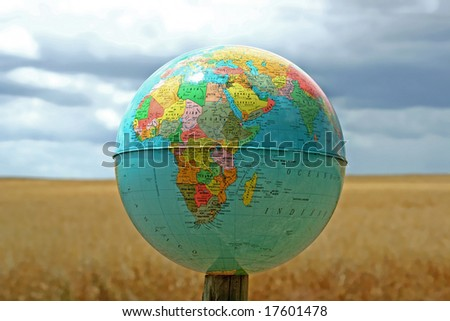 Globe world map real background cereal stock photo 17601478 globe with world map in a real background with cereal field and blue sky gumiabroncs Image collections