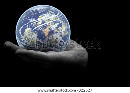 Globe world earth in the palm of your hand - stock photo