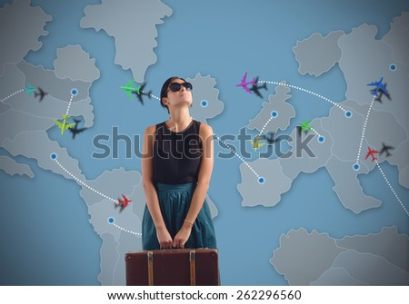 Globetrotting woman looking for a new destination - stock photo