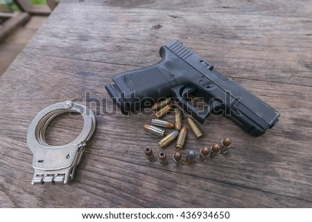glock 19 gen4 hand gun and bullets and shackle on the wood table - stock photo