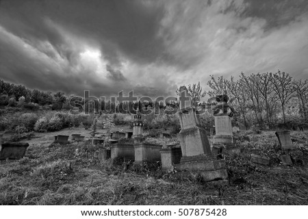 gloomy ancient cemetery under a dark sky