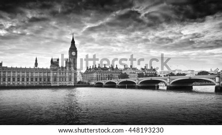 Gloomy and dark image of Houses of Parliament and Westminster bridge - stock photo