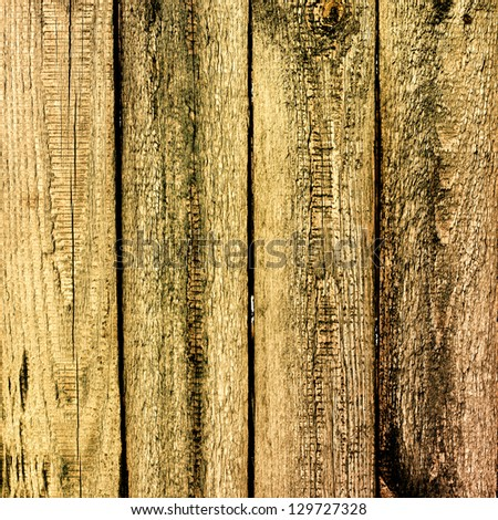 Gloomy old cracked wooden planks, rustic background - stock photo