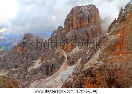 Gloomy sky above abrupt walls of Monte Cristallo, Dolomite Alps, Italy - stock photo