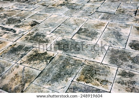 Gloomy textured background dirty marble tile street - stock photo