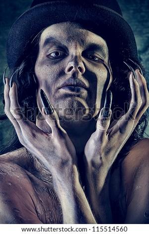 Gloomy vampire standing at the night background. Halloween. - stock photo