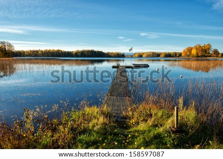Glorious autumn morning by a lake in Sweden