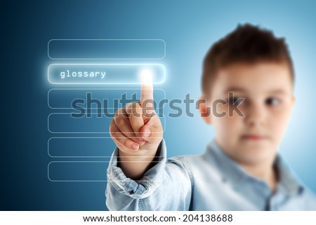 Glossary. Boy pressing a virtual touch screen. Blue background. - stock photo