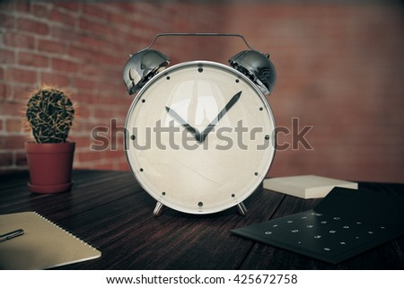 Glossy alarm clock on wooden desk with cactus, calculator and other items on red brick wall background. 3D Rendering - stock photo
