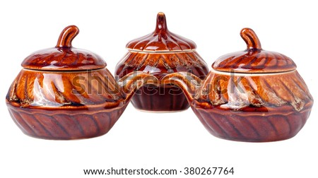 Glossy ceramic pots for cooking isolated on white background. - stock photo