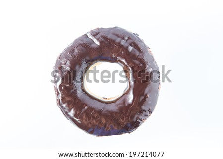Glossy chocolate donut isolated on white background