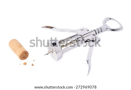 Glossy metal wine bottle opener next to the used cork plug, composition isolated over the white background - stock photo