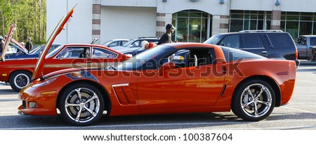 GLOUCESTER, VA- APR 13:An orange Chevy Corvette at the 2nd Annual 2012 MPCC (middle peninsula car club) meeting at the Main St shopping center in Gloucester Virginia on April 13, 2012. - stock photo