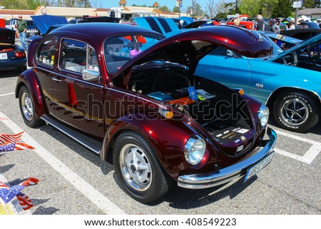 GLOUCESTER, VA - April 16, 2016: A A Volkswagen Beetle at the Daffodil car show with different lighting, the Daffodil car show is held once each year after the  Daffodil parade and festival.