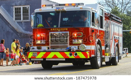 GLOUCESTER, VA - April 5, 2014: 28th annual Daffodil parade, Abingdon Fire and Rescue Engine 51 arriving in the parade, The Daffodil fest and Parade is a regular event held each spring
