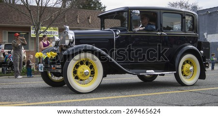 GLOUCESTER, VA - April 11, 2015: Vintage classic antique cars being presented at the 29th annual Daffodil fest and parade, The Daffodil fest and Parade is a regular event held each spring