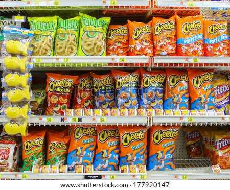 GLOUCESTER, VA - FEBRUARY 13: Cheetos,Fritos & Funyuns snacks. Made by Frito-Lay, a subsidiary of PepsiCo. The Frito Company and H.W. Lay & Company merged in 1961 to form Frito-Lay. In 1965