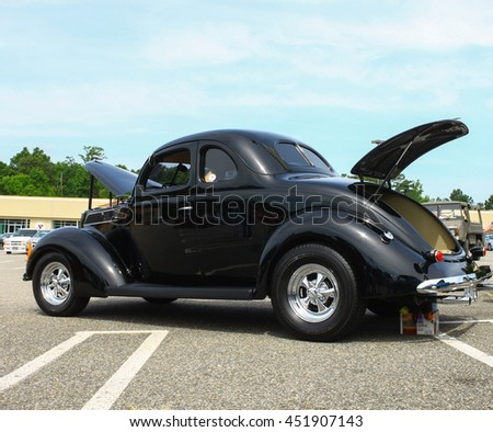 GLOUCESTER, VA - JULY 9, 2016: A black two door Ford Coupe at the Collector Car Appreciation Day Car Show sponsored by the Middle Peninsula Classic Cruisers car club.