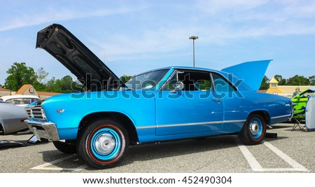 GLOUCESTER, VA - JULY 9, 2016: A blue 1966 Chevrolet Malibu 327 at the Collector Car Appreciation Day Car Show sponsored by the Middle Peninsula Classic Cruisers car club.  - stock photo