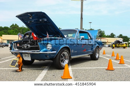 GLOUCESTER, VA - JULY 9, 2016: A blue 1967 Ford Mustang at the Collector Car Appreciation Day Car Show sponsored by the Middle Peninsula Classic Cruisers car club. - stock photo