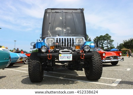 GLOUCESTER, VA - JULY 9, 2016: A Chevrolet powered Jeep Wrangler at the Collector Car Appreciation Day Car Show sponsored by the Middle Peninsula Classic Cruisers car club. - stock photo