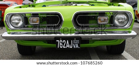 GLOUCESTER, VA- JULY 14:A lime green Dodge at the Annual Blast from the past car show at the Main St shopping center in Gloucester, Virginia on July 14, 2012. - stock photo