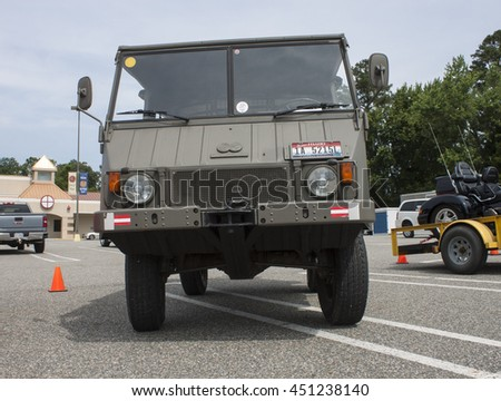 GLOUCESTER, VA - JULY 9, 2016:A Pinzgauer high-mobility all-terrain 4WD (4X4) military utility vehicle at the Collector Car Appreciation Day Car Show sponsored by the Middle Peninsula Classic Cruisers - stock photo