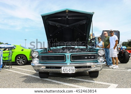 GLOUCESTER, VA - JULY 9, 2016: A 1965 Pontiac GTO at the Collector Car Appreciation Day Car Show sponsored by the Middle Peninsula Classic Cruisers car club.  - stock photo
