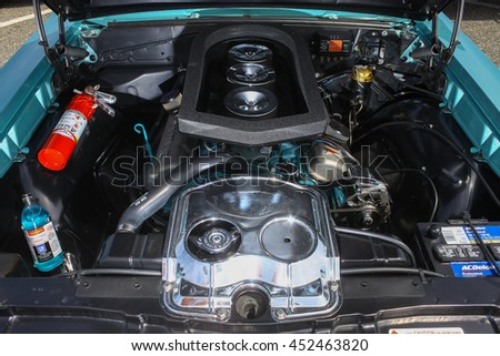 GLOUCESTER, VA - JULY 9, 2016: A 1965 Pontiac GTO six pack engine at the Collector Car Appreciation Day Car Show sponsored by the Middle Peninsula Classic Cruisers car club.  - stock photo