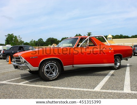 GLOUCESTER, VA - JULY 9, 2016: A red 1969 Chevrolet El Camino at the Collector Car Appreciation Day Car Show sponsored by the Middle Peninsula Classic Cruisers car club.  - stock photo