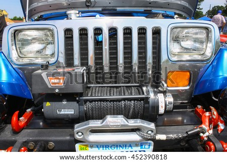 GLOUCESTER, VA - JULY 9, 2016: The front of a Chevrolet powered Jeep Wrangler at the Collector Car Appreciation Day Car Show sponsored by the Middle Peninsula Classic Cruisers car club. - stock photo