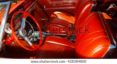 GLOUCESTER, VA - MAY 28, 2016: A red 1965 Chevrolet Impala SS 396 interior at the First Aaron's rental car and Motorcycle show, the show is Sponsored by Aaron's furniture rental of Gloucester - stock photo