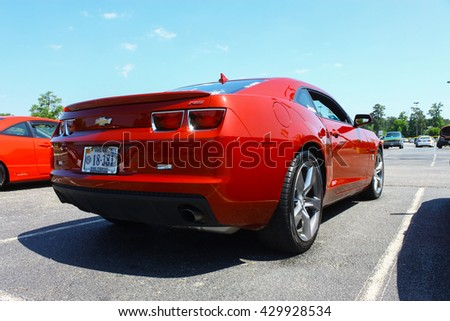 GLOUCESTER, VA - MAY 28, 2016: Burgundy Chevy Camaro with different lighting at the First Aaron's rental car and Motorcycle show, the show is Sponsored by Aaron's furniture rental of Gloucester  - stock photo