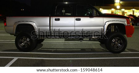 GLOUCESTER, VA- OCTOBER 18: A Large Chevy Pickup in the 30thAnnual 2013 MPCC(middle peninsula car club)meeting at the Main St shopping center in Gloucester, Virginia on October 18, 2013 - stock photo