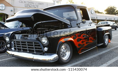 GLOUCESTER, VA- OCTOBER 12:A vintage black pickup at the 29th Annual 2012 MPCC(middle peninsula car club)meeting at the Main St shopping center in Gloucester, Virginia on October 12, 2012 - stock photo