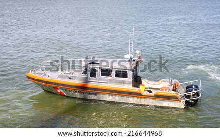 GLOUCESTER, VA - SEPTEMBER 6, 2014: A US Coast Guard marine patrol boat cruising and paroling the York river and Chesapeake bay in Yorktown Virginia on a summer day - stock photo