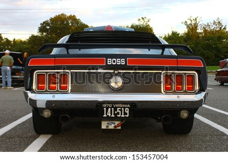GLOUCESTER, VA- SEPTEMBER 6: Back of a Ford Boss 427 Mustang in the 23rd Annual 2013 MPCC(middle peninsula car club)meeting at the Main St shopping center in Gloucester, Virginia on September 6, 2013 - stock photo