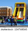 GLOUCESTER, VIRGINIA - APRIL 6: Inflatable Slide in the Daffodil Parade on April 6, 2013 in Gloucester, Virginia. In its 27th year, the parade heralds the arrival of spring. - stock photo