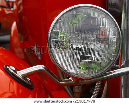 GLOUCESTER, VIRGINIA - AUGUST 23, 2014:A 1931 Chevy 5 window coupe headlight in the DRIVE-IN FOR DIABETES CAR SHOW Sponsored by Tractor Supply in August in Gloucester Virginia. - stock photo